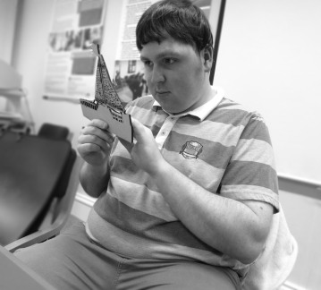 Visually Impaired User Explores the Laser-Cut Model of His Drawing